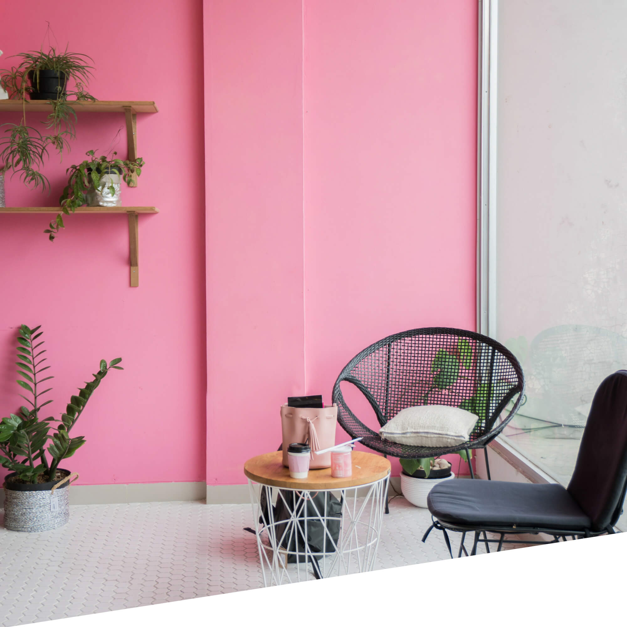 Casual seating with bright pink backdrop