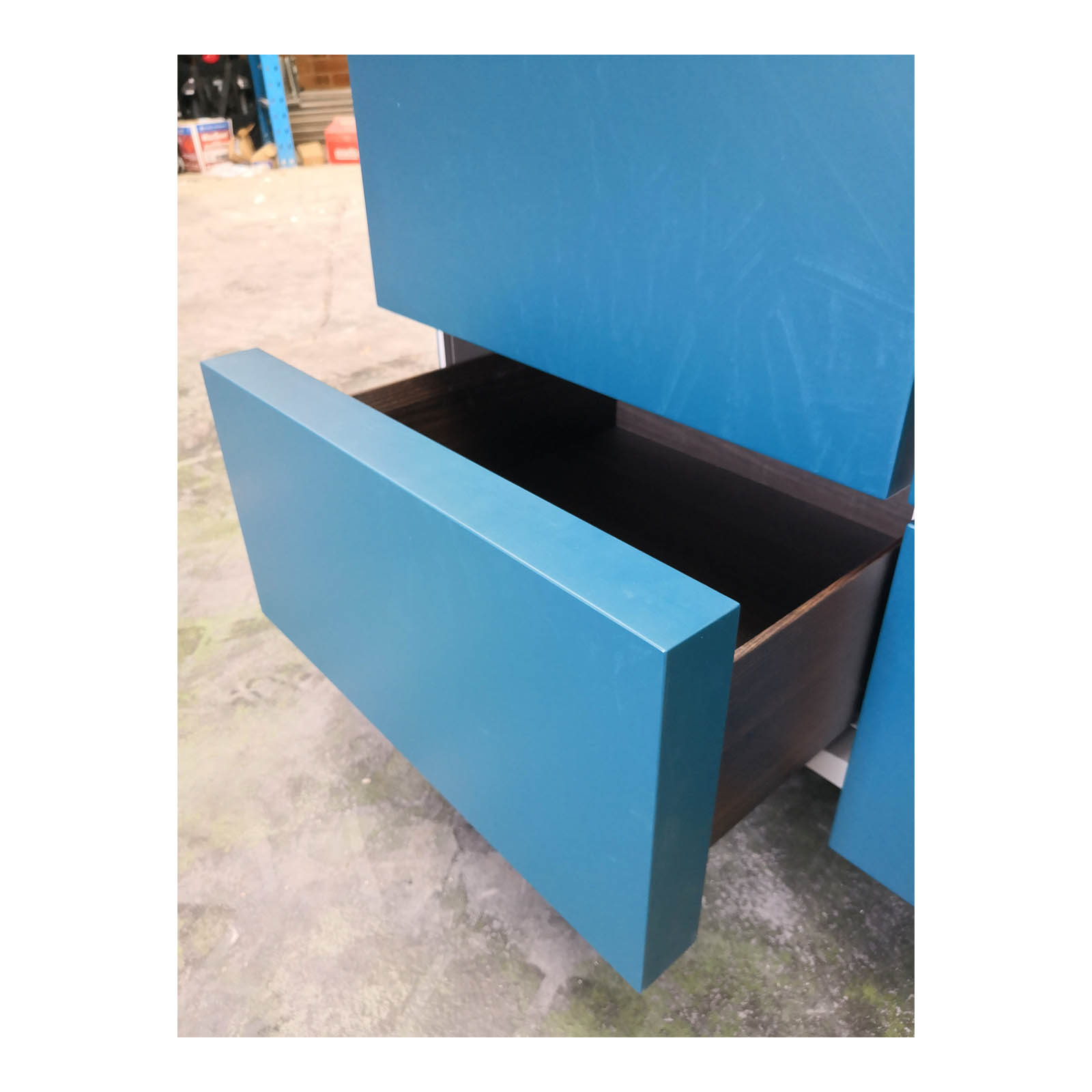 Two Design Lovers teal storage cabinet drawer