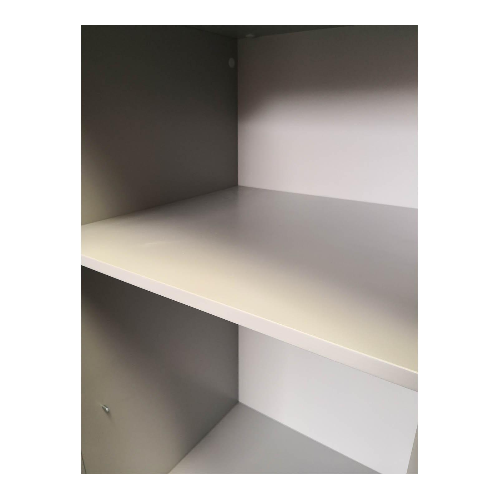 Two Design Lovers teal storage cabinet inside