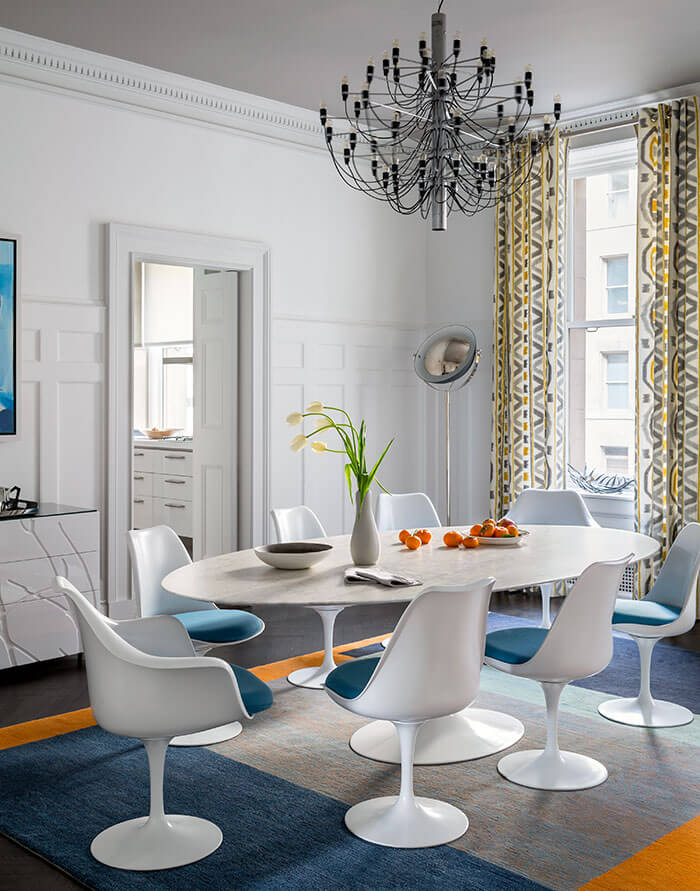 Two Design Lovers dining room Elias Associates Knoll table with aqua rug