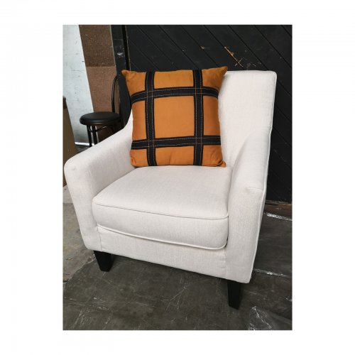 Two Design Lovers Bandhini Designs cushion Hermes grid style on chair