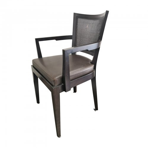 Two Design Lovers eight cane back dining chairs angle view of carver