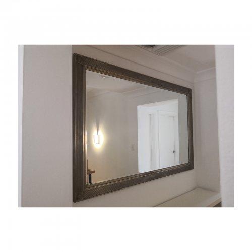 Bevel edge framed mirror on wall