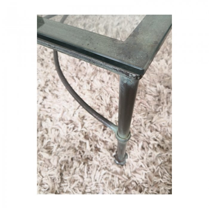 Wrought iron glass topped coffee table leg