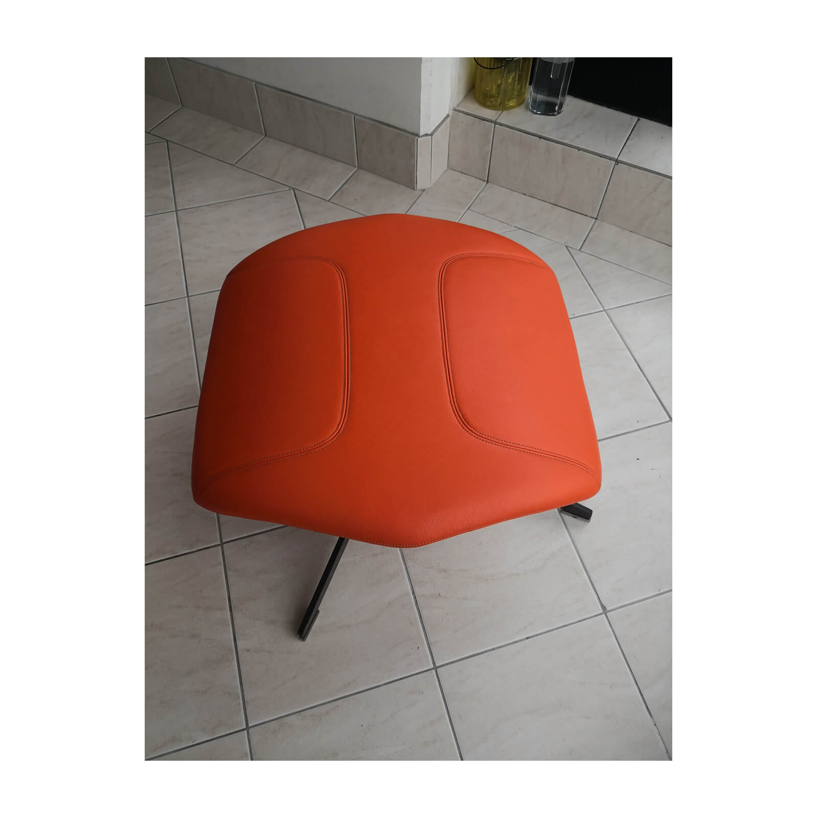Two Design Lovers Moroso Take a Line for a Walk orange swivel chair with footstool 6