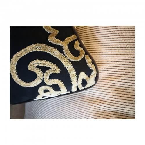 Black velvet cushion with contrast motif
