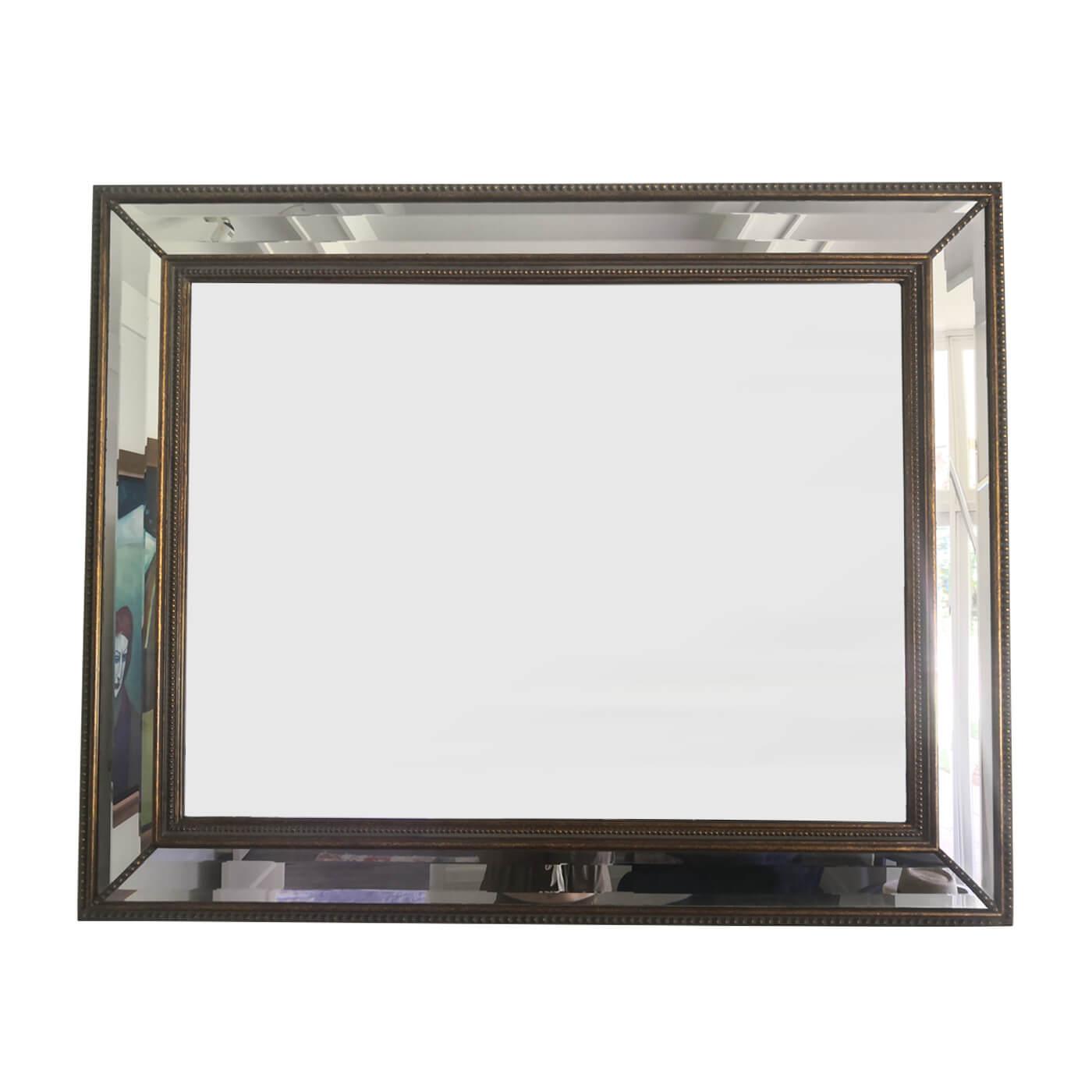 Antique cushion framed mirror