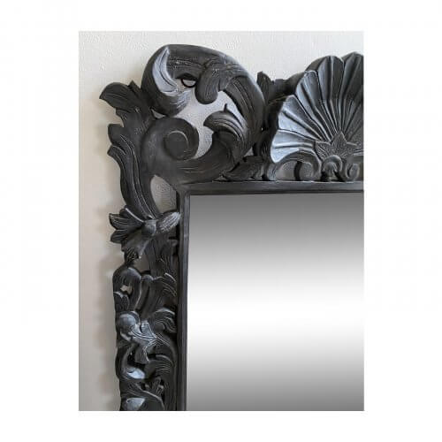 Ornate carved wood mirror in black. Floorstock on sale on Two Design Lovers