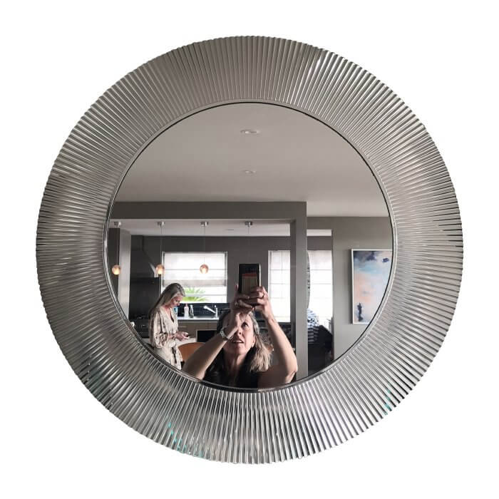 round mirror with fluted mirror edge, purchased at Space Furniture