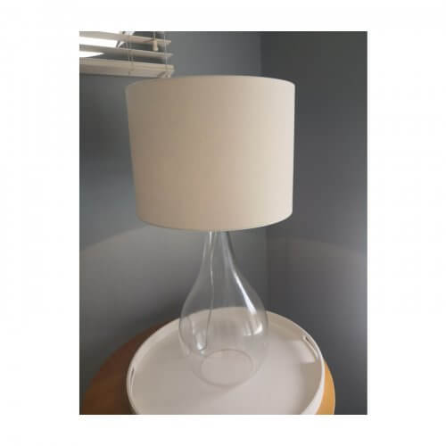 Glass base lamp with cream shade
