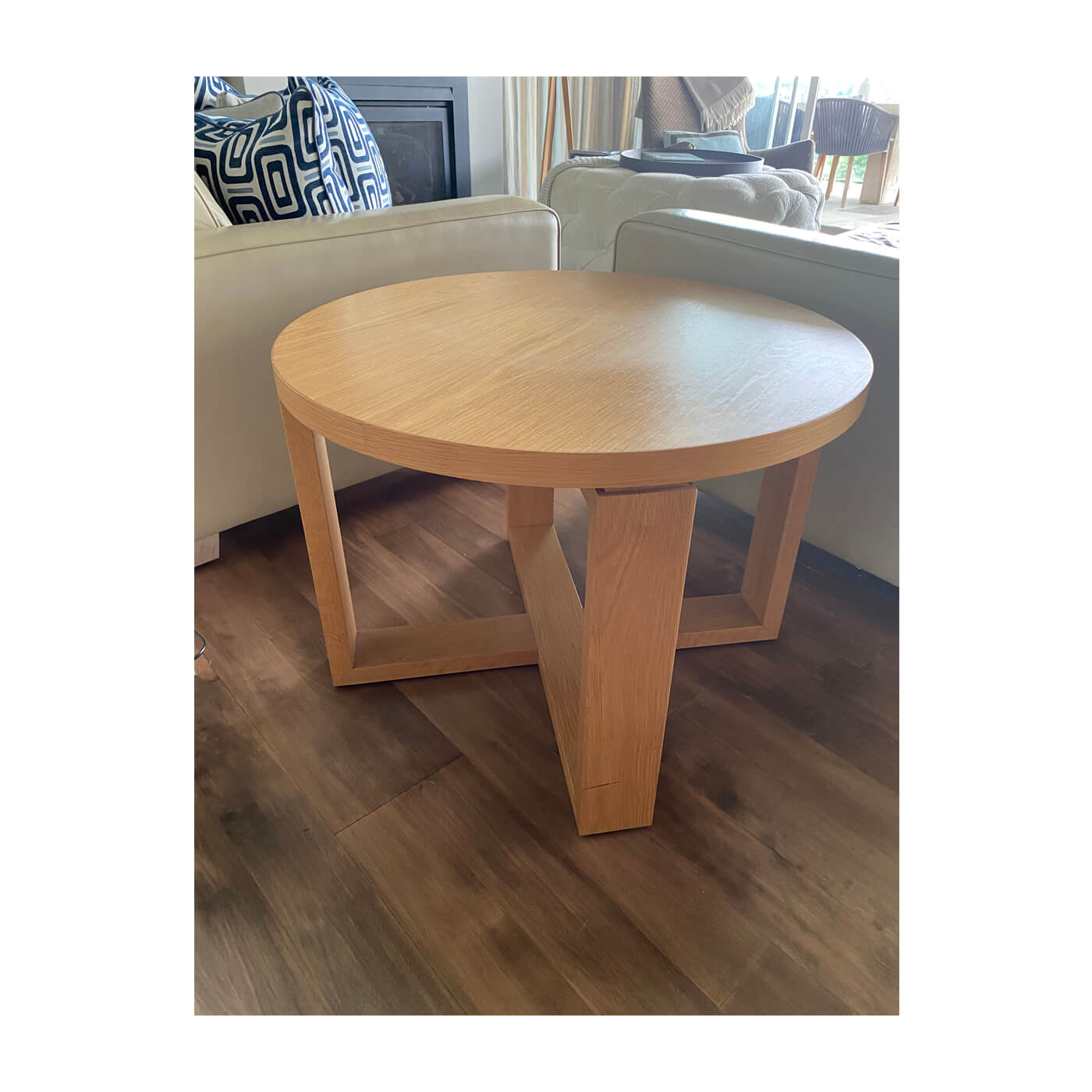 Contemporary round side table with cross base