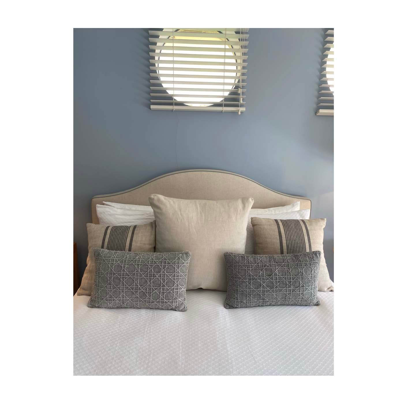 Queen upholstered bedhead in beige with grey piping