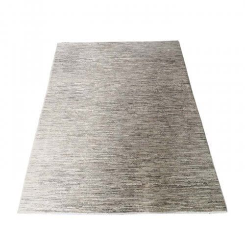 Wool rug in mixed beige tones
