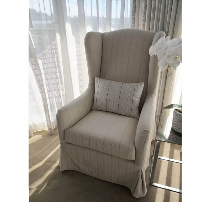 wingback chair in cream fabric with check